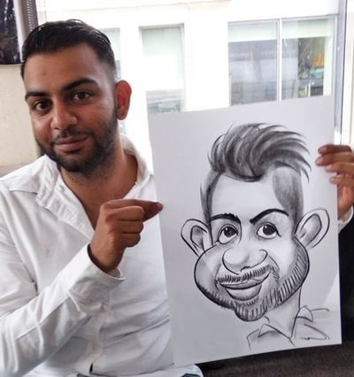Caricature artist draws cheeks