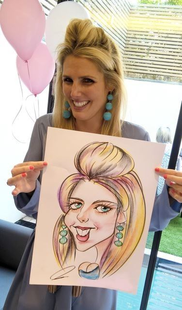 Caricaturist drawing in colour