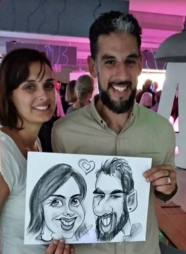 Caricaturist at exhibition