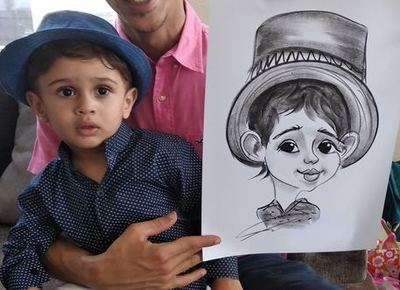 Caricaturist drawing baby