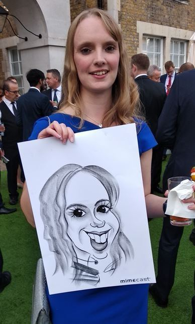 Caricaturist drawing at party