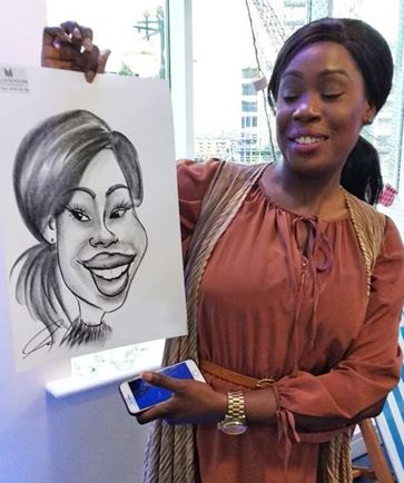Caricaturist drawing girl