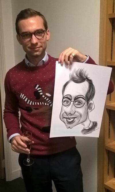 Caricaturist draws man round glasses