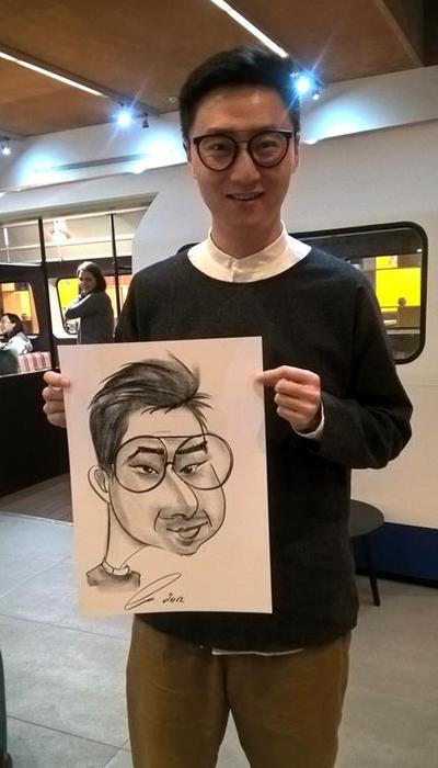 Student with round glasses by Alex Caricaturist