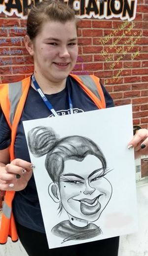 Caricaturist draws Cat smile