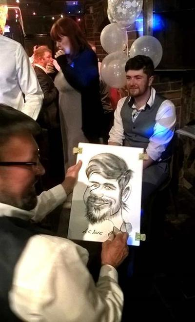 Alex drawing at wedding event